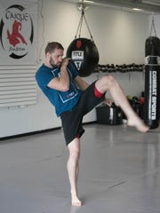 Former MSU wrestler Bobby Nash now a UFC competitor works out at Fuse Mixed Martial Arts in Clinton Township on May 11, 2017.