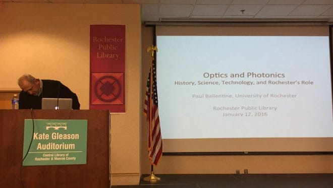Paul Ballentine of the University of Rochester sets up for his public discussion of what photonics is.