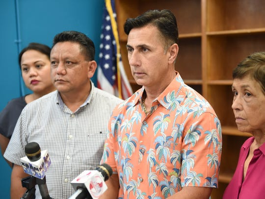 In this file photo, from left, Sharleen Santos-Bamba (representing her uncle, Roy Quintanilla), Roland Sondia, Walter Denton, and Doris Concepcion (representing her late son, Joseph Quinata), announce a lawsuit against former Archbishop Anthony Apuron.