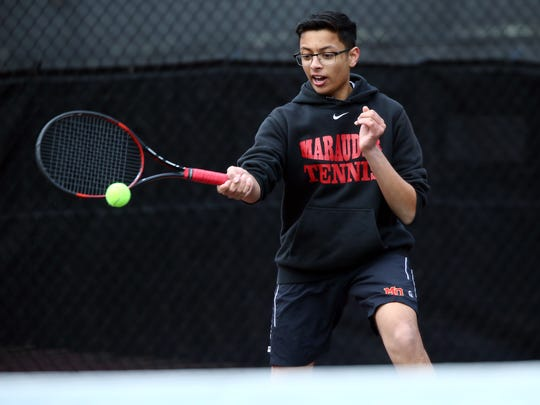Mount Olive's first doubles Anshul Dalua hits a backhand