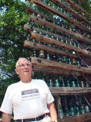 Stanley Hammell by his collection of telegraph insulators.