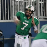 Badin quarterback Zach Larkin, No. 7, completes a pass in the first quarter against West Jefferson in a Division V regional semifinal at Kettering Fairmont Nov. 15, 2014.