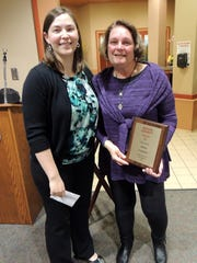 Debra Carpenter was presented with a plaque of appreciation for over 20 years of service to the Special Olympics of Adams County. Debra Carpenter, left, is pictured with Laura Tasto, volunteer coordinator.