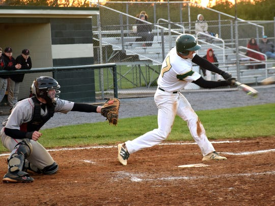 Wilson Memorial's Mike Estes connects for a two-run double in the sixth inning of the Green Hornets' 4-2 victory over Stonewall Jackson in Shenandoah District baseball action on Tuesday, April 18, 2018, at Bo Bowers Stadium in Fishersville, Va.