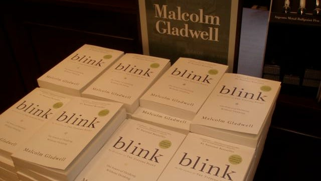 """A stack of the book """"Blink,"""" by Malcolm Gladwell, is on display in an Illinois bookstore."""