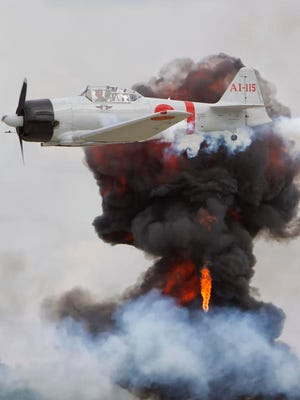 Fighter planes perform in the Tora Tora re-enactment in Friday's airshow August 2, 2013.