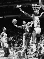 Utah Jazz forward Adrian Dantley elbows his way through