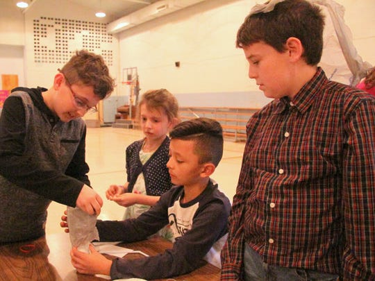 NWP engineers help students design at St. Edward Catholic School in Carlsbad on Wednesday.