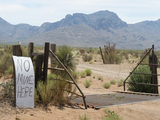 Signs expressing opposition to the mine dot Camino Doce Road. This one, pictured in June, is near the entrance to the proposed mine site.