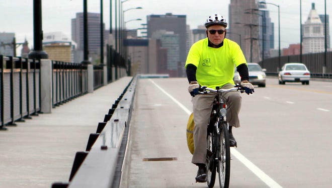 Don Burrell, bicycle/pedestrian coordinator for the Ohio-Kentucky-Indiana Regional Council of Governments, rides his bike along the Eighth Street viaduct in 2011.