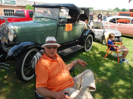 Frank Tricomo, of St. Clair, and his grandson, Sam, sit next to his 1928 Ford roadster, with a rumble seat, at the St. Clair Classic Car Show on Saturday.