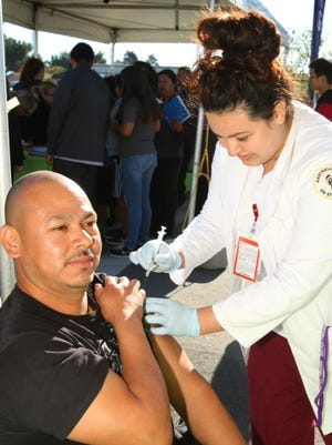 Free flu shots were part of the festivities at the wellness center opening in Gonzales.