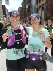 Shippensburg's Nicole Albright, right, and her sister Kacy Elwood of McSherrystown, pose for a photo after completing the Pittsburgh Marathon last weekend. Both runners completed the race in 3:55.