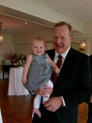 The late Jim Johannson lovingly holds his daughter, Ellie, who now is 2-years old.