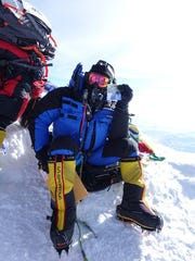 McLeland suited up for his climb to the summit of Mt.