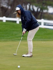 Mendham's Lindsay Perrin watches her putt during their
