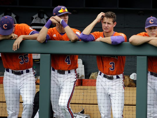 Clemson's Mike Triller (35), Eli White (4), Tyler Krieger (3) and Shane Kennedy (11) watch during the top of the ninth inning of their 18-1 loss to Oregon in an NCAA college baseball regional tournament game on Friday, May 30, 2014, in Nashville, Tenn. (AP Photo/Mark Humphrey)