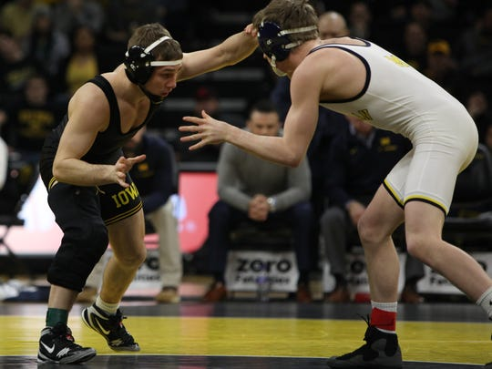 Iowa's Spencer Lee wrestles Michigan's Drew Mattin at 125 pounds during the Hawkeyes regular-season meet against Michigan at Carver-Hawkeye Arena in Iowa City on Saturday, January 27, 2018. Lee won his match with a 15-0 technical fall whereas Iowa would ultimately lose to the Wolverines 17-19 in team points. (Ben Roberts/Freelance)