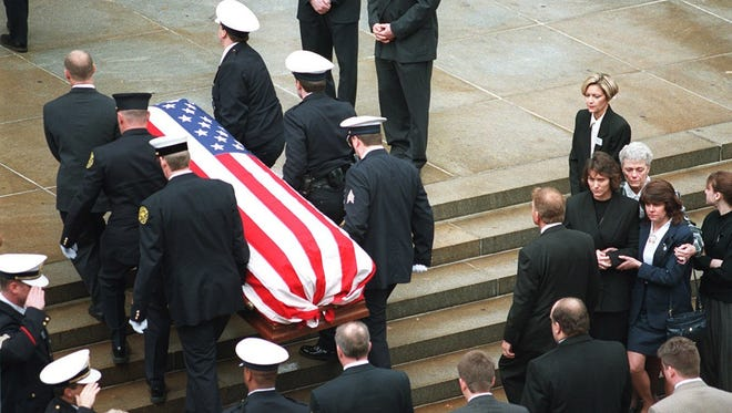 The funeral of Officer Daniel Pope in December of 1997. Pope and his partner, Spc. Ronald Jeter were killed in the line of duty.