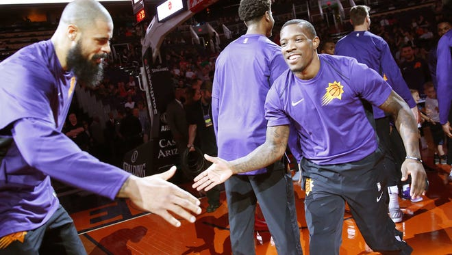Eric Bledsoe (right) headlines the young Suns roster.