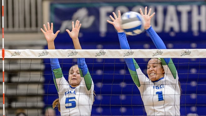 FGCU's Gigi Meyer (5) and Olivia Mesner go up for the block at home against Lipscomb last season.