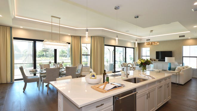 The easy flow of the Messina's open floor plan contributes to the livability and ambiance presented by the first-floor residences in the Coach Homes at Corsica.