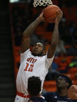 UTEP's Terry Winn grabs a re bound between Rice's Marquez Letcher-Ellis, right, and Connor Cashaw Friday.