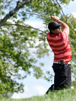 Newark Catholic grad Sean Thomas watches his tee shot on the par-5 15th hole during the final round of the Zanesville District Golf Association Amateur tournament on Saturday at Zanesville Country Club. Thomas shot a 4-under-par 68 to win by 13 shots.