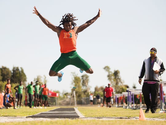 Seneca Milledge, of Dunbar High School, won the long jump event on Friday during the Lee County Athletic Conference meet at South Fort Myers High School. Milledge jumped 23 feet 8 inches.