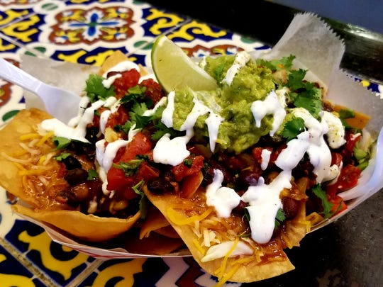 """Taco Shack's Mexican """"Narley"""" nachos were extra thick and crunchy chips with generous amounts of tasty chili, cheese, pico, guacamole and a decorative garnish of lime crema."""