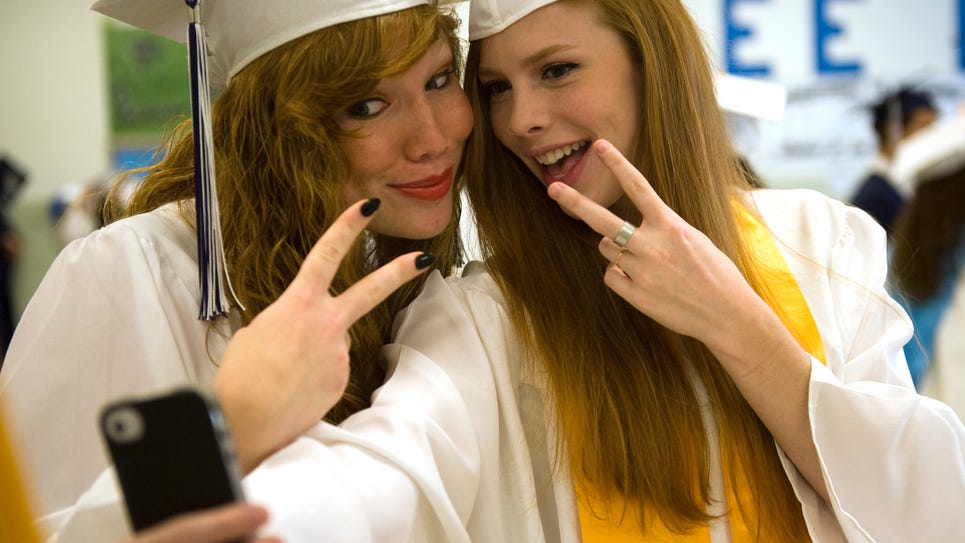 Abby Eimers and Haney Evans snap a selfie before the start of R.E. Lee High School's 2014 Commencement on Saturday, June 7, 2014 at the school.