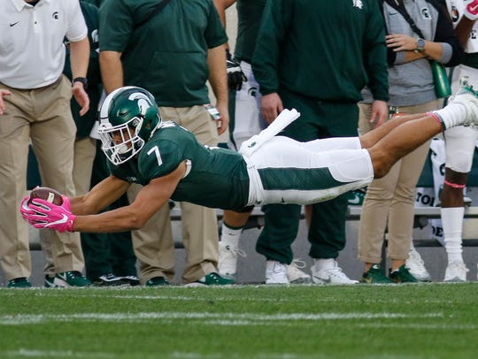 MSU WR Cody White snags a pass Saturday, Oct. 21, 2017