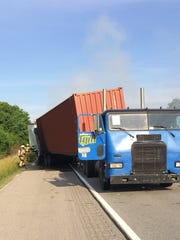 A two semi crash shutdown I-64 in Warrick County Friday
