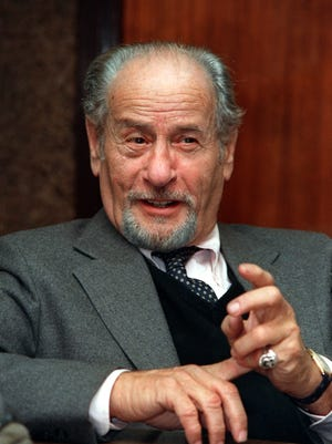 Actor Eli Wallach speaks during a 1987 interview in New York. Wallach, the raspy-voiced character actor who starred in dozens of movies and Broadway plays over a remarkable and enduring career, died Tuesday of natural causes. He was 98.