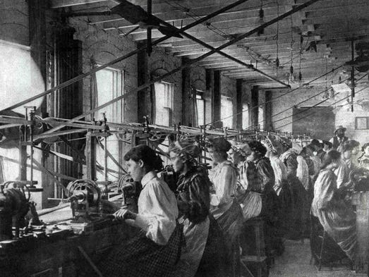 Women grind blanks in a button factory. Two Iowa towns,