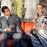 """Henry Cavill as Napoleon Solo with Elizabeth Debicki in """"The Man from U.N.C.L.E."""""""