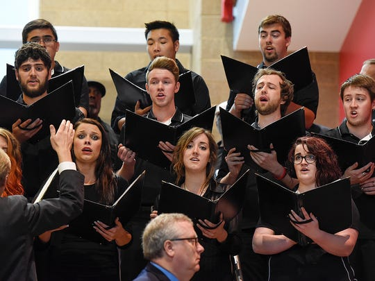 """Members and alumni of the St. Cloud State University concert choir sing the """"University Hymn"""" at an interfaith memorial for Earl H. Potter III Friday, June 17, at the Herb Brooks National Hockey Center."""
