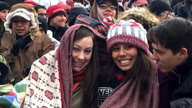 Fans bundle up against the cold Saturday at the Hyundai Sun Bowl.