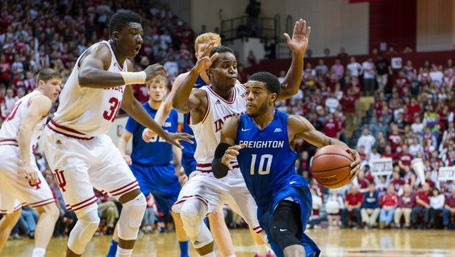 Creighton guard Maurice Watson Jr. (10) drives the ball into the lane against the defense of Indiana center Thomas Bryant (31), left, and guard Yogi Ferrell (11) during the first half of an NCAA college basketball game, Thursday, Nov. 19, 2015, in Bloomington, Ind. (AP Photo/Doug McSchooler)