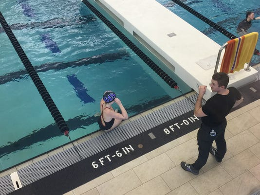636529290454217385-0206-11-FHSswimmer-WithCoach.jpg