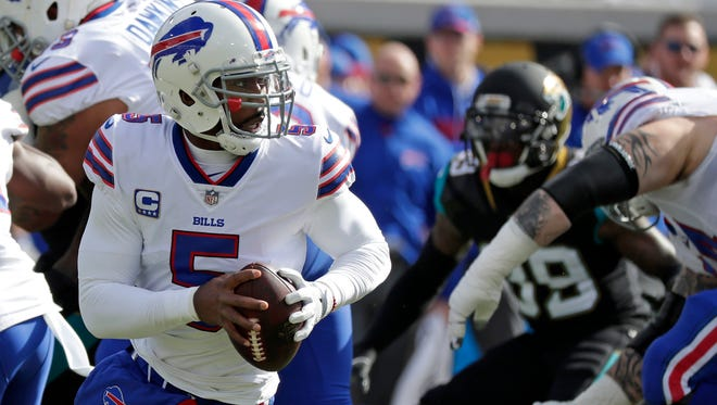 Buffalo Bills quarterback Tyrod Taylor looks for a receiver against the Jacksonville Jaguars in the first half of an NFL wild-card playoff football game, Sunday, Jan. 7, 2018, in Jacksonville, Fla. (AP Photo/John Raoux)