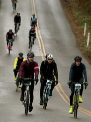 Cyclists speed down Battle Point Drive during Cascade