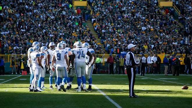 The Detroit Lions huddle in the second quarter against the Green Bay Packers at Lambeau Field on Nov. 15, 2015, in Green Bay, Wisconsin.
