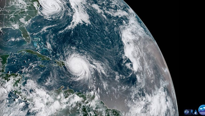 Hurricane Maria roars over Puerto Rico on Wednesday, Sept. 21, 2017, as Jose spins south of New England. So far, Maria's worst devastation has been on the islands of Dominica and Puerto Rico.