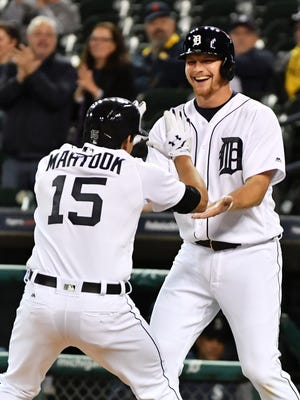 Tigers' Mikie Mahtook celebrates his two-run home run with John Hicks, who also scored in the eighth inning.