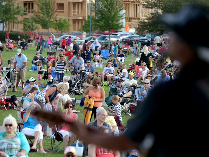 The crowd listens to The Blue River Band perform at the Nickel Plate Amphitheater, Tuesday, July 8, 2014, in Fishers. Thousands of people turn out weekly for the concert series.