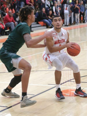 In a rare start, Mansfield Senior's Christian Haney made three 3-pointers and scored 13 points in the Tygers' win over crosstown rival Madison.