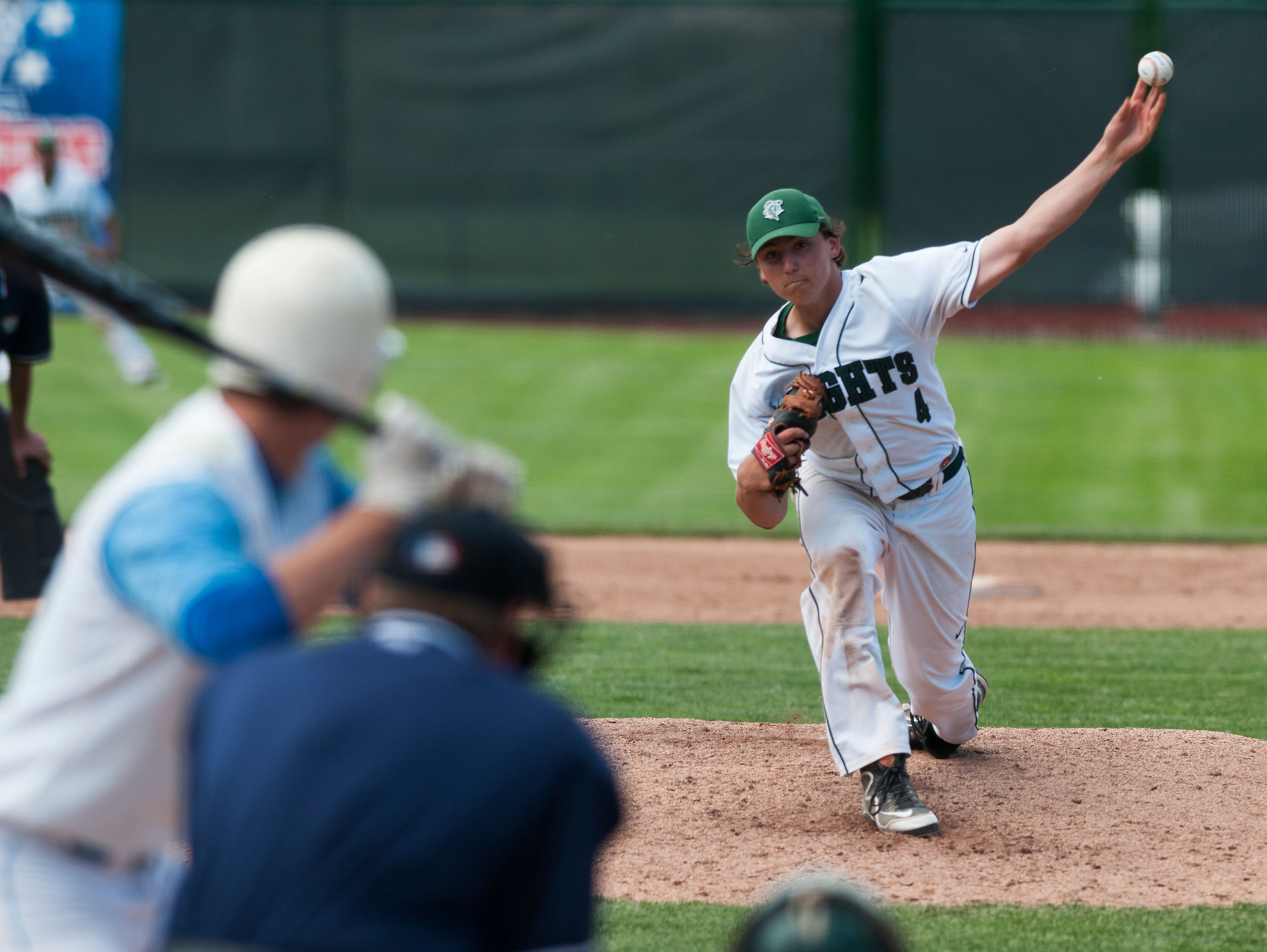 Rice pitcher Will Hesslink (4) delivers a pitch during the Division I high school baseball championship against South Burlington at Centennial Field last year.