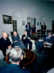 White House Secret Service agent Frank Yeager stands with his arms crossed in the back of the back of Oval Office on Oct. 18, 1962, as President John F. Kennedy meets with Minister of Foreign Affairs of the Soviet Union (USSR), Andrei Gromyko, seated right next to Kennedy.  Yeager worked in Kennedy's detail as a special agent from 1961-1963, until Kennedy's assassination.