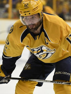 Predators center Mike Fisher (12) during a break in the action in first period in game 3 of the second round NHL Stanley Cup Playoffs at the Bridgestone Arena on April 30.